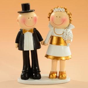 Kaketopp Dekorativt brudepar med gulldetaljer