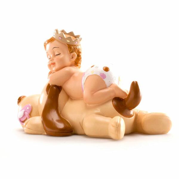 Kaketopp dåp - sovende jente på hund